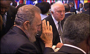 Historic handshake: Castro raises his hand during lunch in the company of Georgia's Eduard Shevardnadze