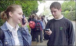Young people with mobile phones