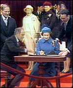 The Queen signing the act that repatriated the Canadian constitution