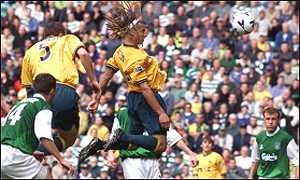 Henrik Larsson heads home his second goal of the game
