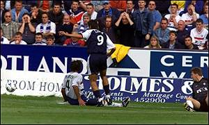 Lorenzo Amoruso falls to the ground as Juan Sara scores Dundee's equalising goal