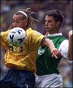 Larsson shields the ball from Paul Fenwick