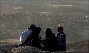 Palestinian refugees enjoy a picnic overlooking Baqaa Camp in Jordan