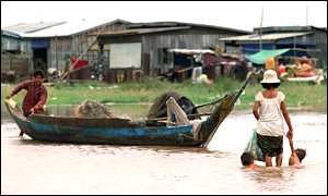 Cambodia women and her children in Mekong river