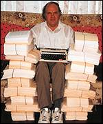 Les Stewart, surrounded by his 19,990 page manuscript