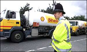Tanker being watched by policeman