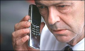 Man speaking into mobile phone