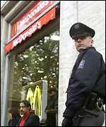 Prague policeman outside McDonalds restaurant