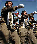 Armed volunteers of the Iranian Basiji Islamic militia parading on the anniversary