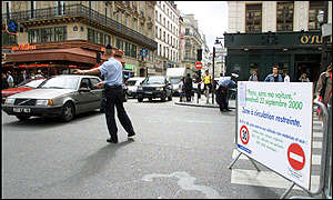 Traffic police directs traffic in Paris, France