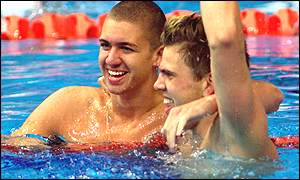 The muscles worked - Hall Jr tied for gold with fellow American Anthony Ervin (left)