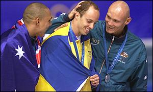 100m butterfly gold medal winner Lars Froelander with Australia's Geoff Huegill (bronze) and Michael Klim (Silver)