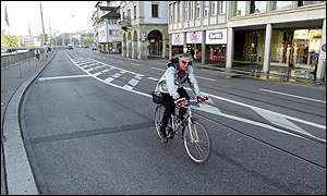 Cyclist rides on empty Zurich streets