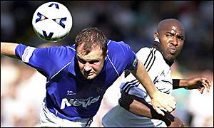 Barry Ashby of Gills (left) clears from Barry Hayles
