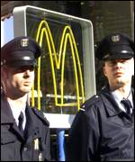 Police guard a McDonald's outlet