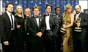 Actor Martin Sheen with the cast of The West Wing