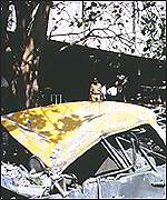 Destroyed taxi outside the Air India offices in Bombay 1993