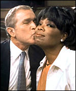 Mr Bush kisses host Oprah Winfrey