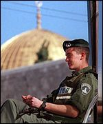 Israeli soldier near the Dome of the Rock