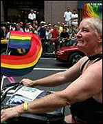 A member of Dykes on Bikes rides along Fifth Avenue
