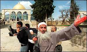 Palestinians carrying victim of clashes on Temple Mount