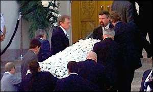 image: [ Frank Sinatra's flower-laden casket is carried into the vigil ]