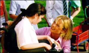 Gaby Roslin and a girl in a wheelchair