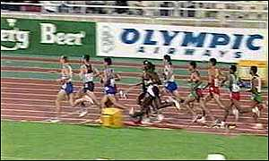 Athletes running round a race track