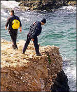 Divers searching for bodies from the sinking of the Express Samina