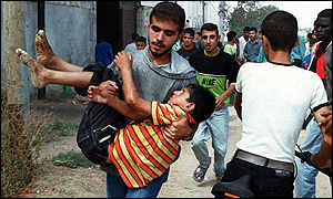 Palestinian carrying wounded child