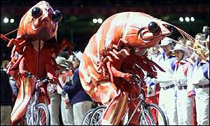 Performers dressed as giant prawns