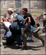 Wounded man being carried away