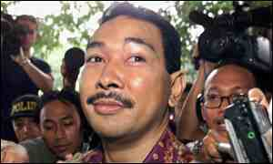 Tommy Suharto arrives to answer a summons