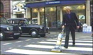 James Dyson with one of his bagless cleaners