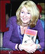 JK Rowling with Harry Potter book