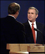 Al Gore and George Bush face each other