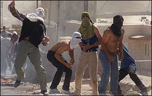 Palestinians throw stones in east Jerusalem