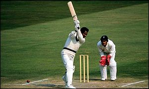 Alan Knott watches Gary Sobers in action