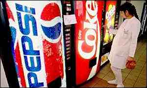 A woman chooses between Pepsi and Coca Cola