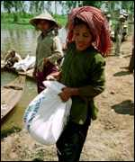 Girl with bag of rice in Vietnam