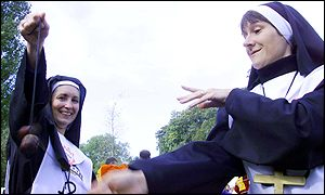 Women dressed as nuns swing their conkers
