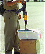 Policeman with ballot box