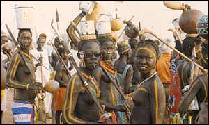 nuba women prepare for a celebration
