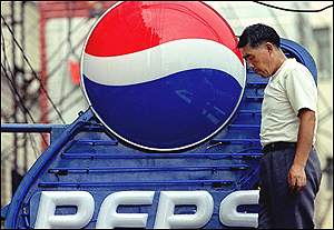Chinese worker erects Pepsi sign in Shanghai