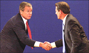 Bush and Gore shake hands after the debate