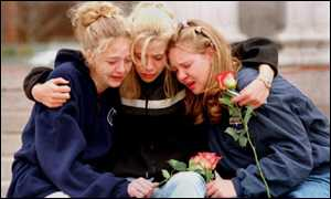 teenagers weeping for victims of the Columbine High School shooting in April last year