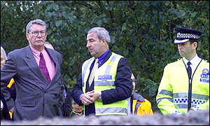 Lord Macdonald briefed by police at the scene