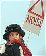 Child at an anti-noise protest