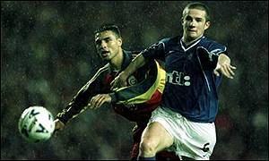Akyel Faith tussles with Barry Ferguson at Ibrox