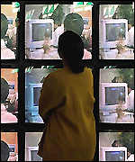 Woman watching PC screens